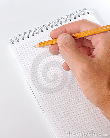 Hand whith  pencil writing in notebook