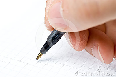 An hand who writes in a paper sheet with a pen