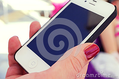 Hand of woman with smartphone