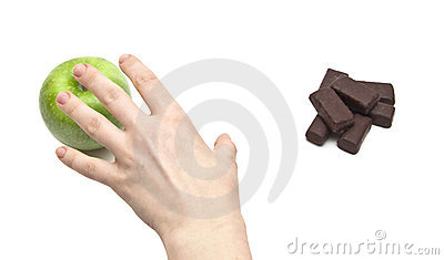 Hand women choosing apple against chocolate