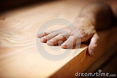 Hand on wood