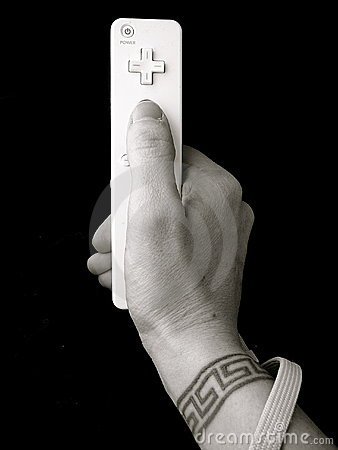 Hand with wrist tattoo holding video game control Editorial Image