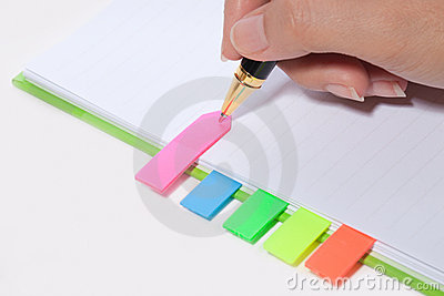 Hand writing on bookmark of notebook