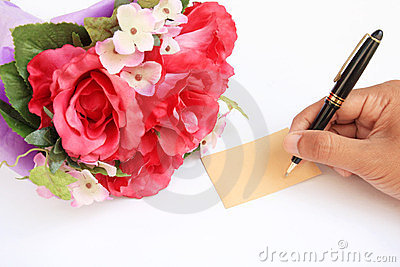 Hand writing card and rose