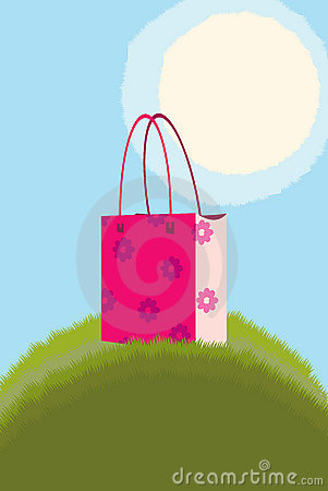 Handbag on green grass