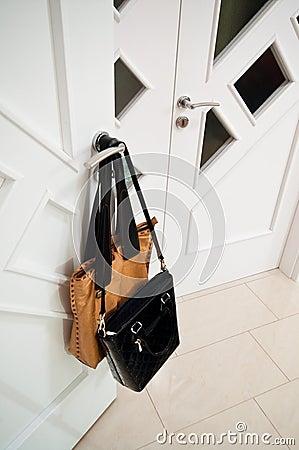 Handbags on door handle