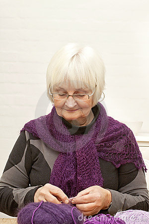 Handcraft - Old woman knitting