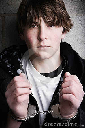 Handcuffed teen portrait