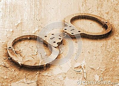 Handcuffs on grunge