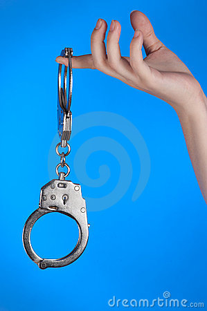 Handcuffs in hand