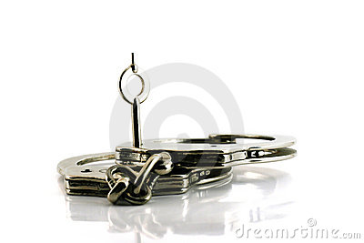 Handcuffs with key in focus