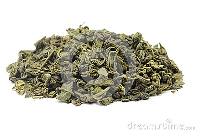 A handful of dried green tea leaves