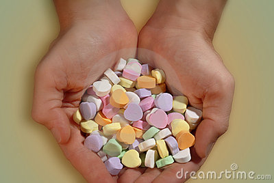 Handful of Valentine candy.