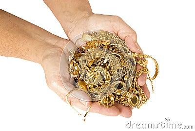 Handfullguld som är klar att sälja för kassa