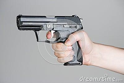 Handgun in the hand