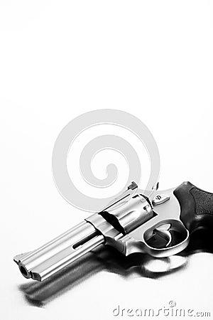 Handgun on steel surface