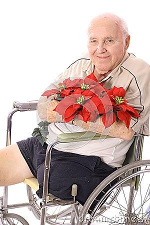 Handicap man in wheelchair with flowers