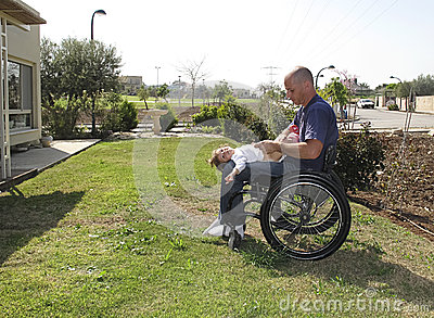Handicapped dad with child