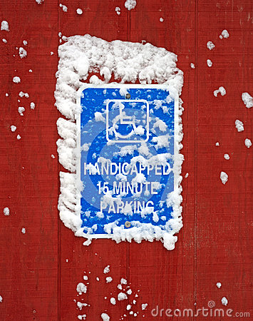 Free Handicapped Parking Sign With Snow Stock Image - 48755481
