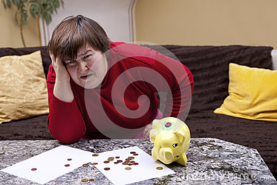 Disabled woman look desperate in front of her bills