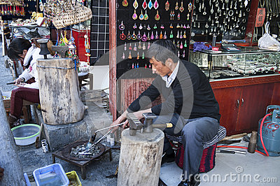 Handicraftsman in Dali ancient town Editorial Image