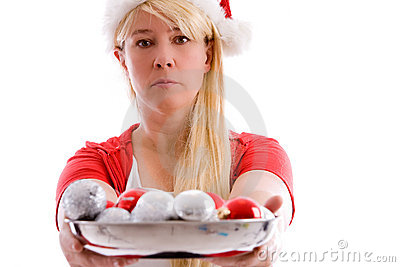 Mature woman with christmas hat handing the baubles over