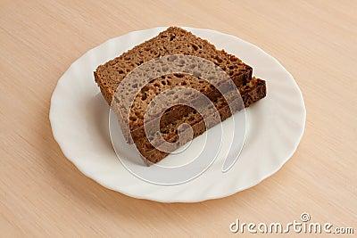 Handmade black bread on plate
