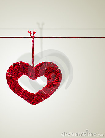 Handmade heart made from red threads