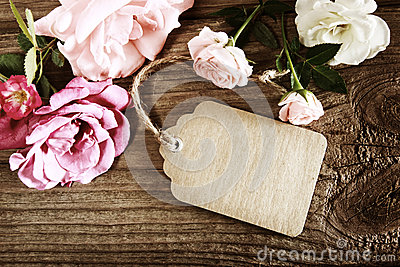 Handmade paper tag with string and roses