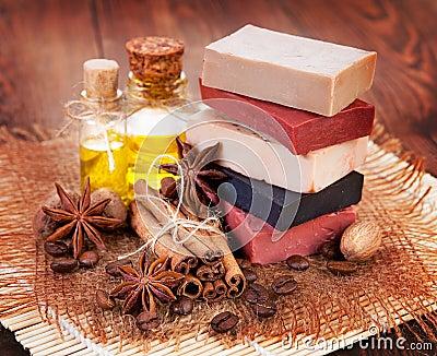 Handmade soap, oil in bottles anise and cinnamon