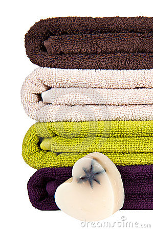 Handmade soap and stacked colorful towels