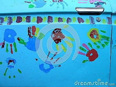 Handprints Closeup on Car Door