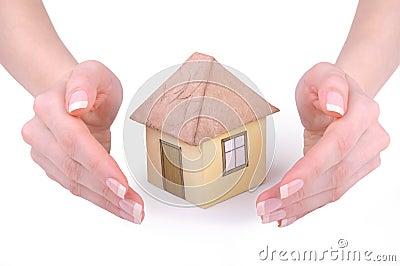 Hands around model house
