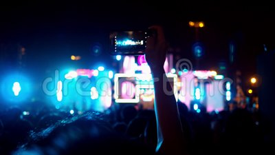 Hands of audience crowd people taking photo with mobile smart phone concert on music festival.  stock video footage