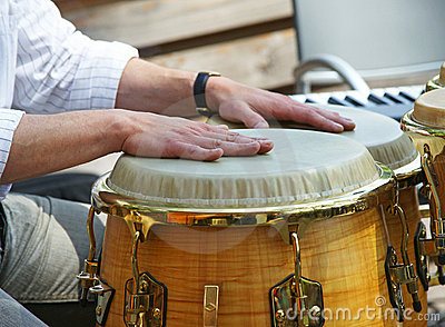 Hands on bongo drums