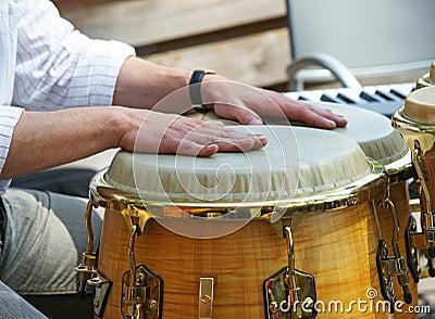 Hands on bongo drums