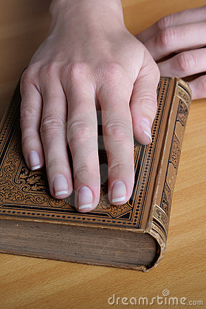 hands with the book