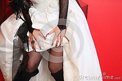 Hands of bride and hem of dress