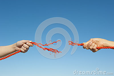 Hands broken rope sky background