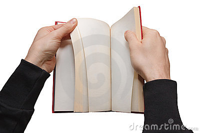 Hands browsing a book