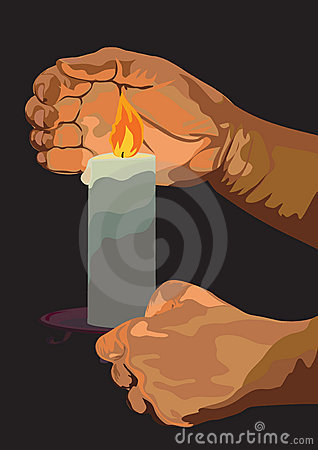 Hands with a burning candle