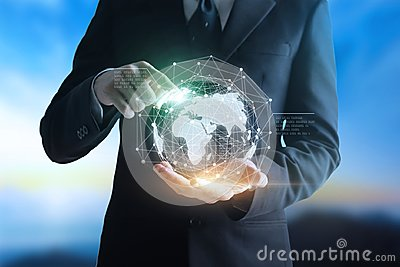 Hands businessman touching Technologies connecting the world. Stock Photo