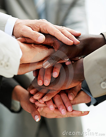 Hands of businesspeople on top of each other