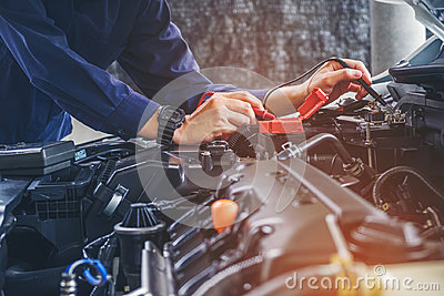 Hands of car mechanic working in auto repair service. Stock Photo