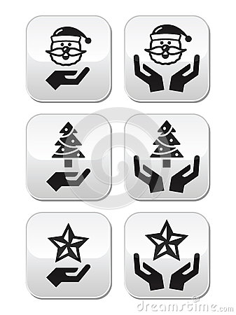 Hands with christmas buttons - santa claus, tree, star