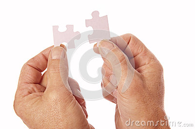 Hands connect jigsaw puzzle pieces