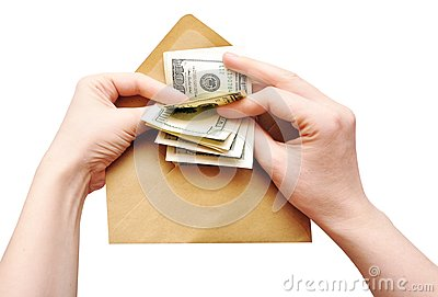 Hands is counting a cash in an envelope