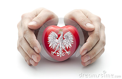 Hands covering Polish coat of arms