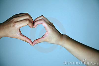 Hands creating heart shape