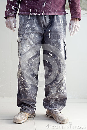 Hands dirty trousers of plastering painter man